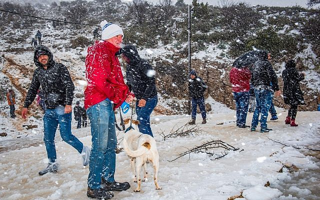People enjoy the snow in the Druze village of Majdal Shams, in the Golan Heights, northern Israel, on January 19, 2018. (Basel Awidat/Flash90)