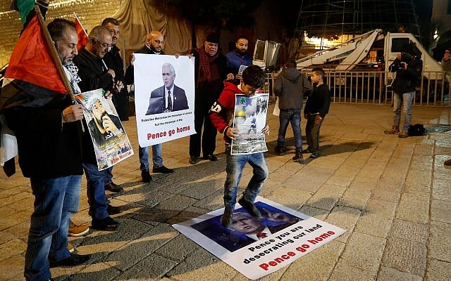 Palestinians protest against the visit of US Vice President Mike Pence outside the Church of Nativity, in the West Bank city of Bethlehem on January 21, 2018. (Wisam Hashlamoun/ Flash90)