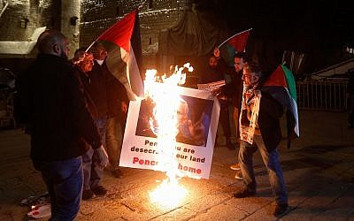 Palestinians protest against the visit of US Vice President Mike Pence outside the church of nativity in the West Bank city of Bethlehem on January 21, 2018. (Wisam Hashlamoun/Flash90)