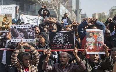 African asylum seekers and human rights activists protest against their planned deportation in front of the Rwandan embassy in Herzliya on January 22, 2018. (Flash90)