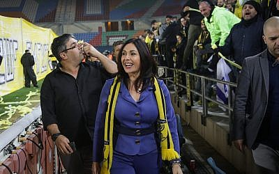 Culture and Sports Minister Miri Regev seen with fans before the start of a match between Beitar Jerusalem and Bnei Sakhnin F.C., at the Teddy Stadium in Jerusalem on January 22, 2018. (Roy Alima/Flash90)
