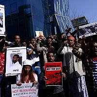 African asylum seekers and human rights activists protest against deportation in front of the Rwandan Embassy in Herzeliya, on January 22, 2018. (Tomer Neuberg/Flash90)