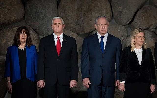 US Vice President Mike Pence, 2nd left, and his wife Karen, left, with Prime Minister Benjamin Netanyahu, 2nd right, and his wife Sara during a ceremony at the remembrance hall at the Yad Vashem Holocaust Memorial Museum in Jerusalem, on January 23, 2018. (Noam Revkin Fenton/Yad Vashem)