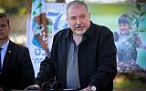 Defense Minister Avigdor Liberman during a ceremony for the Jewish holiday of Tu Bishvat in Kibbutz Kfar Aza, in southern Israel, January 31, 2018. (Flash90)