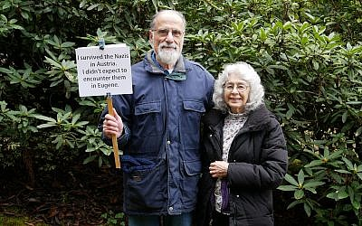 George and Judy Tanner pose with the sign they held at a February rally after a surge in neo-Nazi and anti-Semitic graffiti appeared in Eugene, Oregon. (Judy Tanner)