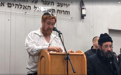 MK Yehudah Glick (Likud) eulogizes his wife, Yaffa, at her funeral at Jerusalem's Har Hamenuhot cemetery on January 1, 2018. (Screen capture: Facebook)