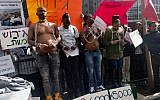 Eritrean activists held a mock slave auction to protest planned deportations outside of the Rwandan embassy in Herzilya on January 22, 2018. (Melanie Lidman/Times of Israel)