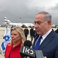 Prime Minister Benjamin Netanyahu, and his wife Sara Netanyahu, at Ben Gurion airport on January 23, 2018. (Jacob Magid/Times of Israel)