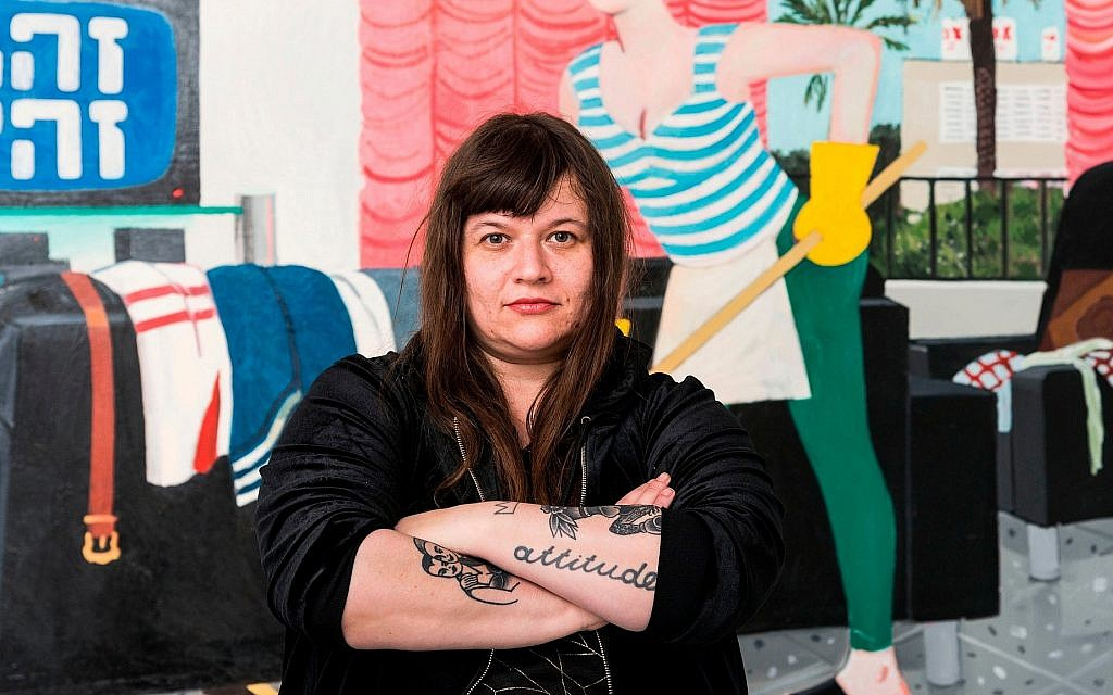 Artist Zoya Cherkassky poses in front of one of her works in her solo exhibition 'Pravda' at the Israel Museum. (Eli Pozner/Israel Museum)