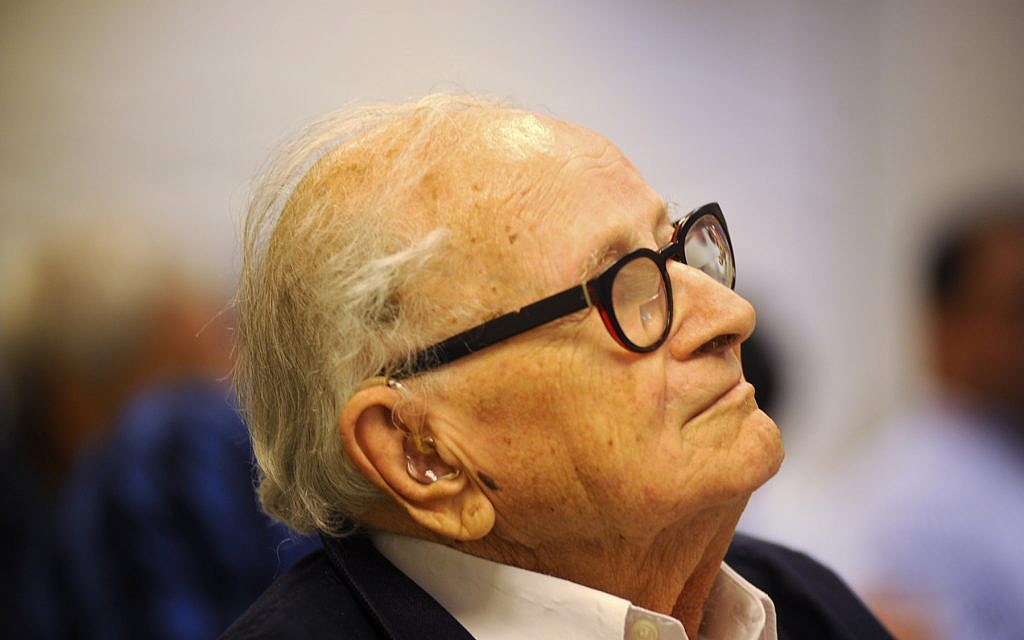 Former Mossad spy chief Rafi Eitan, 90, listens to speakers during a Tel Aviv seminar on doing business in Cuba. Eitan's Grupo BM has extensive interests on the island. (Larry Luxner/Times of Israel)