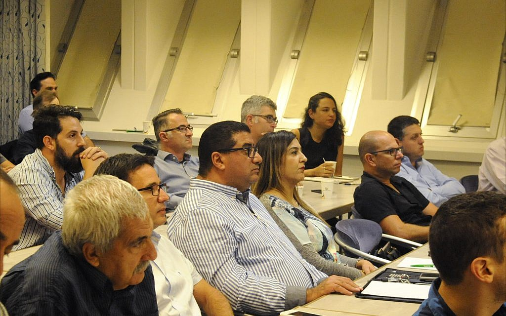 Israeli executives listen to a November 9 presentation in Tel Aviv about doing business in Cuba. (Larry Luxner/Times of Israel)