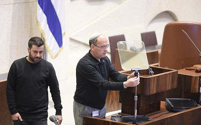 Workers installing teleprompters for Mike Pence's speech at the Knesset on January 21, 2018. (Yitzhak Harari/Knesset)