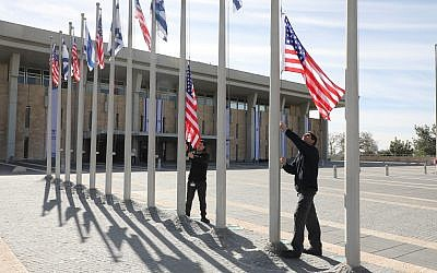 Workers installing flags for Mike Pence's visit to the Knesset on January 21, 2018. (Yitzhak Harari/Knesset)