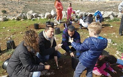 Pupils from Benzion Netanyahu school in the Samaria-area settlement Barkan at their school archaeological excavation. (Roi Hadi)