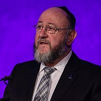 Chief Rabbi Ephraim Mirvis speaks at a National Holocaust Memorial Day event at the Queen Elizabeth II Conference Centre on January 26, 2017, in London, England. (Jack Taylor/Getty Images)
