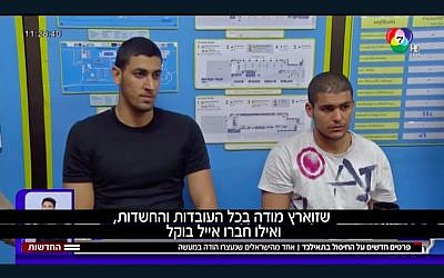 Eyal Bokel (L) and Dolev Zuaretz sit while in Thai police custody on January 22, 2018. (Screen capture/Hadashot news)