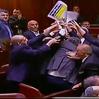 "Knesset ushers eject lawmakers from the Joint (Arab) List from the plenum after they hold up signs reading ""Jerusalem is the capital of Palestine"" at the start of US Vice President Mike Pence's speech on January 22, 2018. (Screen capture/Twitter)"