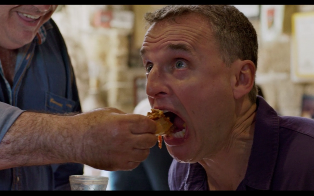 Dr. Shakshuka feeds Phil Rosenthal in 'Somebody Feed Phil.' (Netflix)