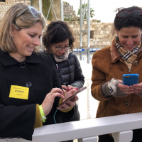Female reporters covering Mike Pence's visit to the Western Wall. Tal Schneider is at left.  (Michael Lipin/Twitter, via JTA)