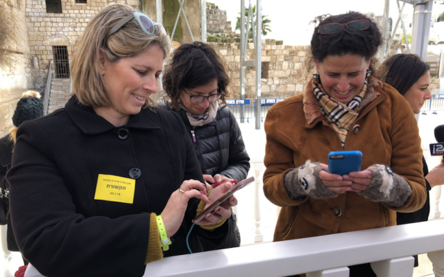 Female reporters covering Mike Pence's visit to the Western Wall on January 23, 2018. Tal Schneider is at left. (Michael Lipin/Twitter, via JTA)