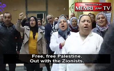 Activists in Tunisia demonstrate against a Holocaust exhibition held at the National Library there, on December 15, 2017. (Screen capture: MEMRI)