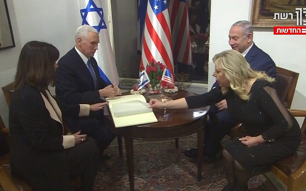 US Vice President Mike Pence and Second Lady Karen Pence sign the guestbook at the prime minister's residence in Jerusalem, across from Prime Minister Benjamin Netanyahu and his wife, Sara (screen capture: Channel 2)