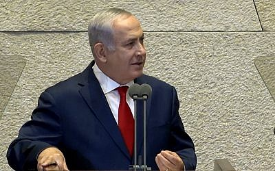 Prime Minister Benjamin Netanyahu addresses the Knesset plenum during a special session with visiting US Vice President Mike Pence, January 22, 2018 (screen capture: YouTube)