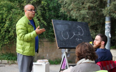 Linguist and Arabic teacher Anwar Ben-Badis teaching and guiding in Jerusalem's Katamon neighborhood during one of his intensive courses (Courtesy Anwar Ben-Badis)