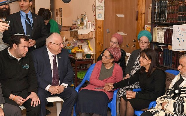 President Reuven Rivlin (second to left) makes a condolence visit to the family of Raziel Shevach in the Havat Gilad outpost on January 18, 2018. (Credit: Mark Nyman)