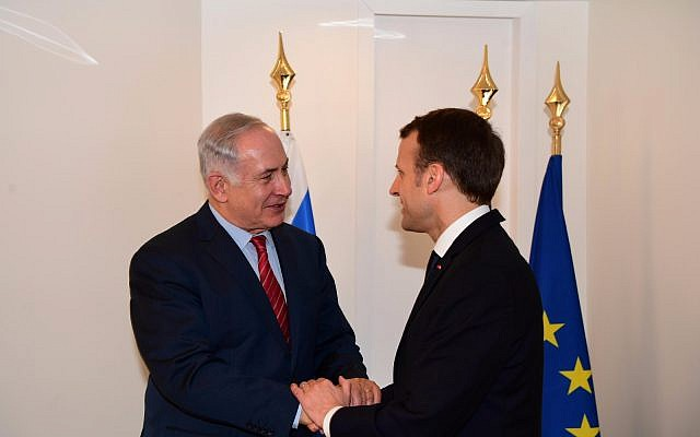 Prime Minister Benjamin Netanyahu meets with French President Emmanuel Macron at the World Economic Forum in Davos