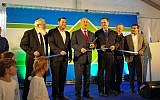 Prime Minister Benjamin Netanyahu (c) cuts the ribbon at the inauguration ceremony of a new bypass road in the northern West Bank on January 30, 2018. (Samaria Regional Council)