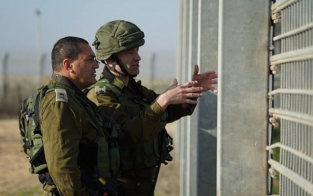The head of the Southern Gaza Brigade, Col. Kobi Heller, right, and IDF Southern Command chief Maj. Gen. Eyal Zamir visit the Kerem Shalom Crossing on January 14, 2018, where an alleged Hamas attack tunnel was discovered and destroyed by the military the day before. (Israel Defense Forces)