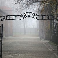 The infamous German inscription that reads 'Work Makes Free' at the main gate of the Auschwitz I extermination camp in Oswiecim, Poland, on November 15, 2014. (Christopher Furlong/Getty Images via JTA)