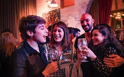 "Attendees at TIIF""S  the Wine on the Vine launch party in Jaffa, January 18, 2018. (Aviram Valdman)"