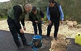 Palestinian forces inspect a roadside bomb found in the West Bank on Saturday, January 27, 2018. (Ma'an news agency)