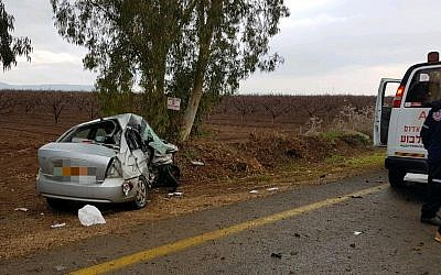 The crumpled passenger car whose driver was killed after a collision with a police patrol car in northern Israel, January 17, 2018. (Magen David Adom)