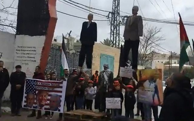 Palestinians in the Aida refugee camp near Bethlehem hang effigies of Donald Trump and Mike Pence, January 27, 2018 (Facebook)