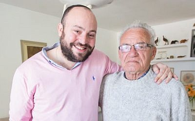 Jonny Daniels meets with Moshe Tirosh on January 13, 2015 in Karmiel, Israel. (Photo by Elan Kawesch via JTA)