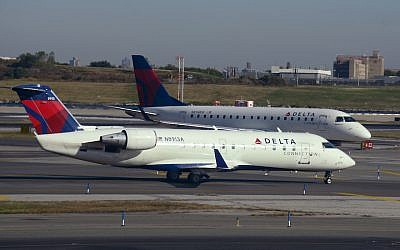 Two Delta Connection passenger jets at LaGuardia Airport in New York, October 2017. (Robert Alexander/Getty Images via JTA)