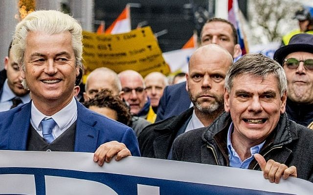 Dutch far-right politician Geert Wilders of the PVV party (L), and Belgium's Vlaams Belang Flemish right-wing party leader Filip De Winter lead a protest march against the policy of Dutch Prime Minister and his cabinet in Rotterdam, on January 20, 2018.  (AFP PHOTO / ANP / Robin UTRECHT / Netherlands OUT)
