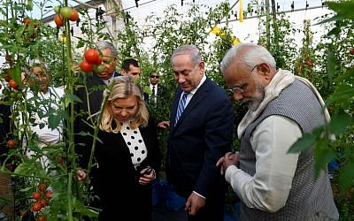 Prime Minister Benjamin Netanyahu and his wife Sara tour the green houses in Gujarat, India, along with Indian Prime Minister Nrenda Modi, on January 17, 2018. (Avi Ohayon/GPO)