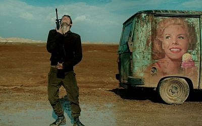 "An Israeli soldier does a mock dance with his rifle in ""Foxtrot."" (Sony Pictures Classics)"