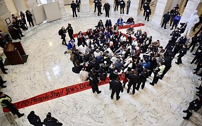 Jewish protesters link arms in a Senate office building asking for protections for undocumented immigrants who arrived as children, Jan. 17 2018. (Religious Action Center of Reform Judaism via JTA)