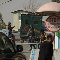 Afghan security personnel man a checkpoint at the entrance to the Intercontinental Hotel in Kabul on January 22, 2018, following a Taliban terror attack on the hotel in which at  least 22 people are now known to have died. (AFP PHOTO / SHAH MARA)