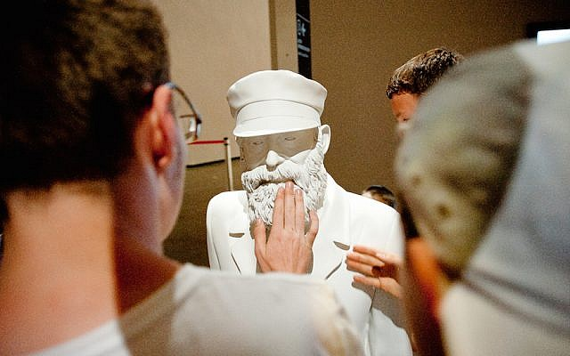 Visitors to the Jewish Museum and Tolerance Center in Moscow viewing one of the many sculptures there depicting the history of Jewish life in Russia, May 21, 2013. (Courtesy of the Jewish Museum and Tolerance Center/via JTA)