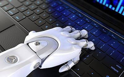Illustrative image of a robot hand typing on a keyboard (iLexx, iStock by Getty Images)