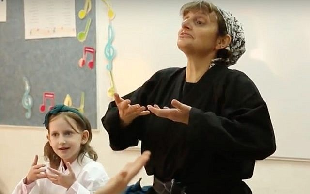 Jill Shames, director of Training and Certification at Kids Kicking Cancer, teaching children breathing techniques (YouTube screenshot)