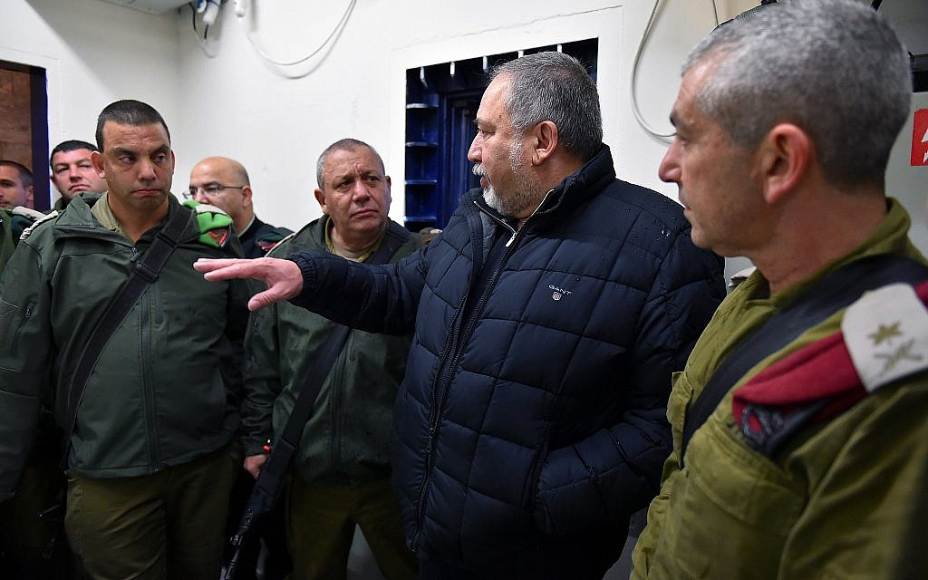 Defense Minister Avigdor Liberman, center-right, meets with IDF chief Gadi Eisenkot, center-left, outgoing head of the IDF's Central Command Maj. Gen. Roni Numa, right, and other senior military officers during a tour of Hebron on February 27, 2018. (Ariel Hermoni/Defense Minister)
