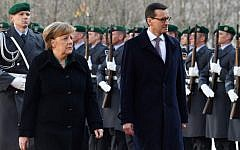 File: German Chancellor Angela Merkel and Polish Prime Minister Mateusz Morawiecki inspect a military honor guard on February 16, 2018 in front of the Chancellery in Berlin. (AFP Photo/John Macdougall)