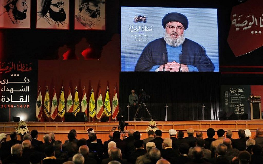 Hezbollah leader Hassan Nasrallah delivers a televised speech during a ceremony held by the terror group in Beirut commemorating its killed leaders on February 16, 2018. (AFP Photo/Joseph Eid)